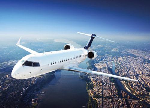 Passenger Plane Flying over city