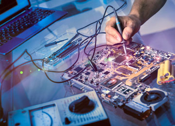 Man soldering electronics (Printed circuit board)